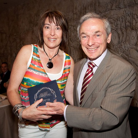 Denise Kelly graduates from CHS to NCAD. Photographed with Minister Bruton.