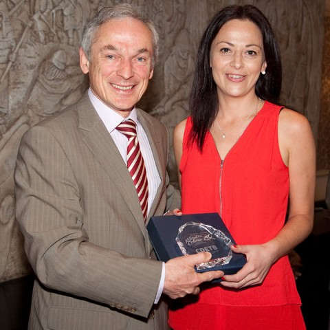 Audrey Doyle from BSC who is heading to NCI pictured here with Minister Bruton